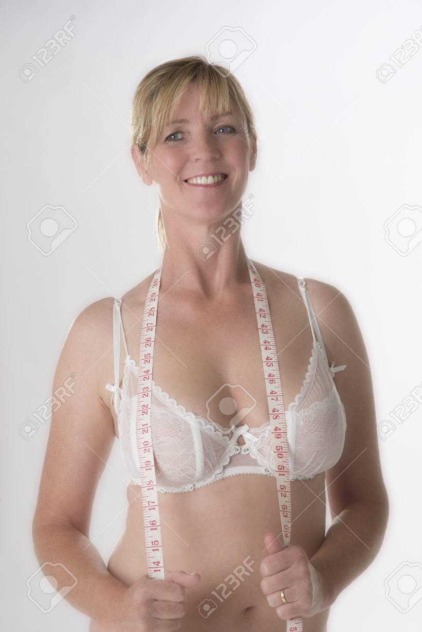 Mature woman holding a tape measure over her bra Stock Photo - 47457689