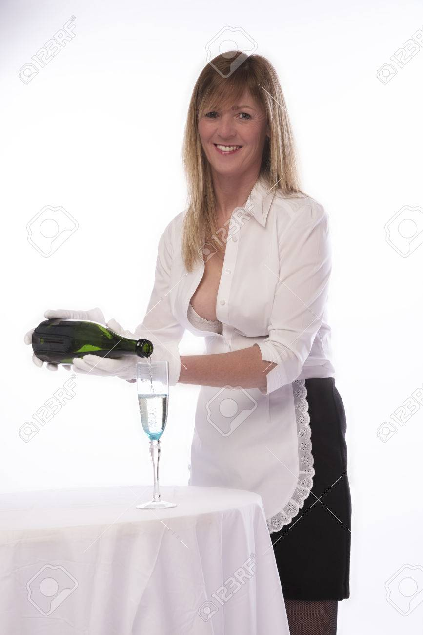 Stock Photo - Waitress in sexy uniform pouring a glass of sparkling wine