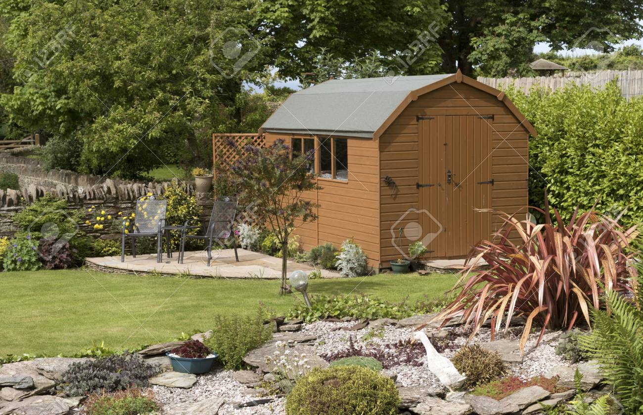 A Dutch Barn Style Garden Shed With A Patio In A English Country ...