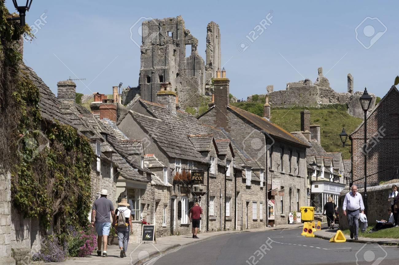 Quaint Street In Corfe Castle Dorset England UK Overlooked By ...