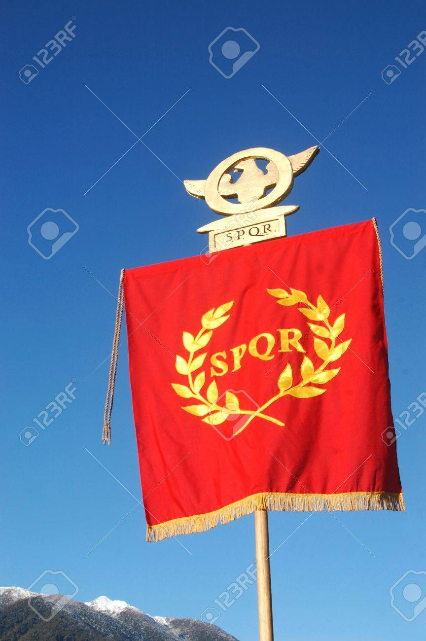 Roman Standard displaying SPQR, against blue sky and alps Stock Photo - 15278954