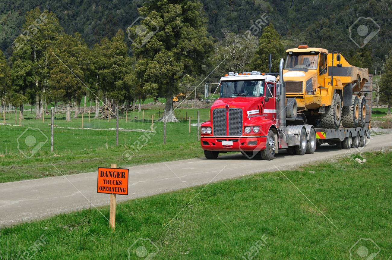 A 30 ton dump truck leaves a construction site in Westland Stock Photo - 16442251