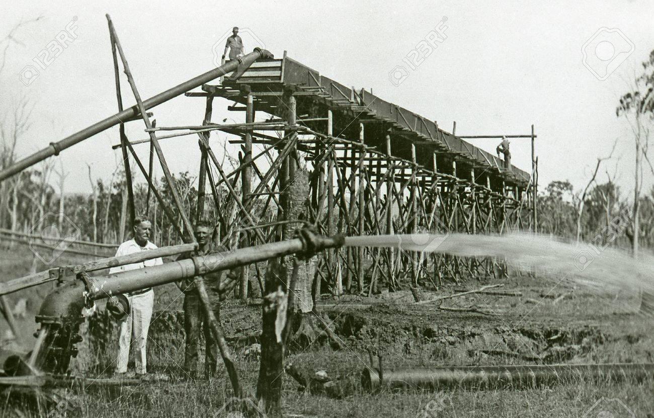 QUEENSLAND, AUSTRALIA, CIRCA 1870: Unidentified men work a sluice