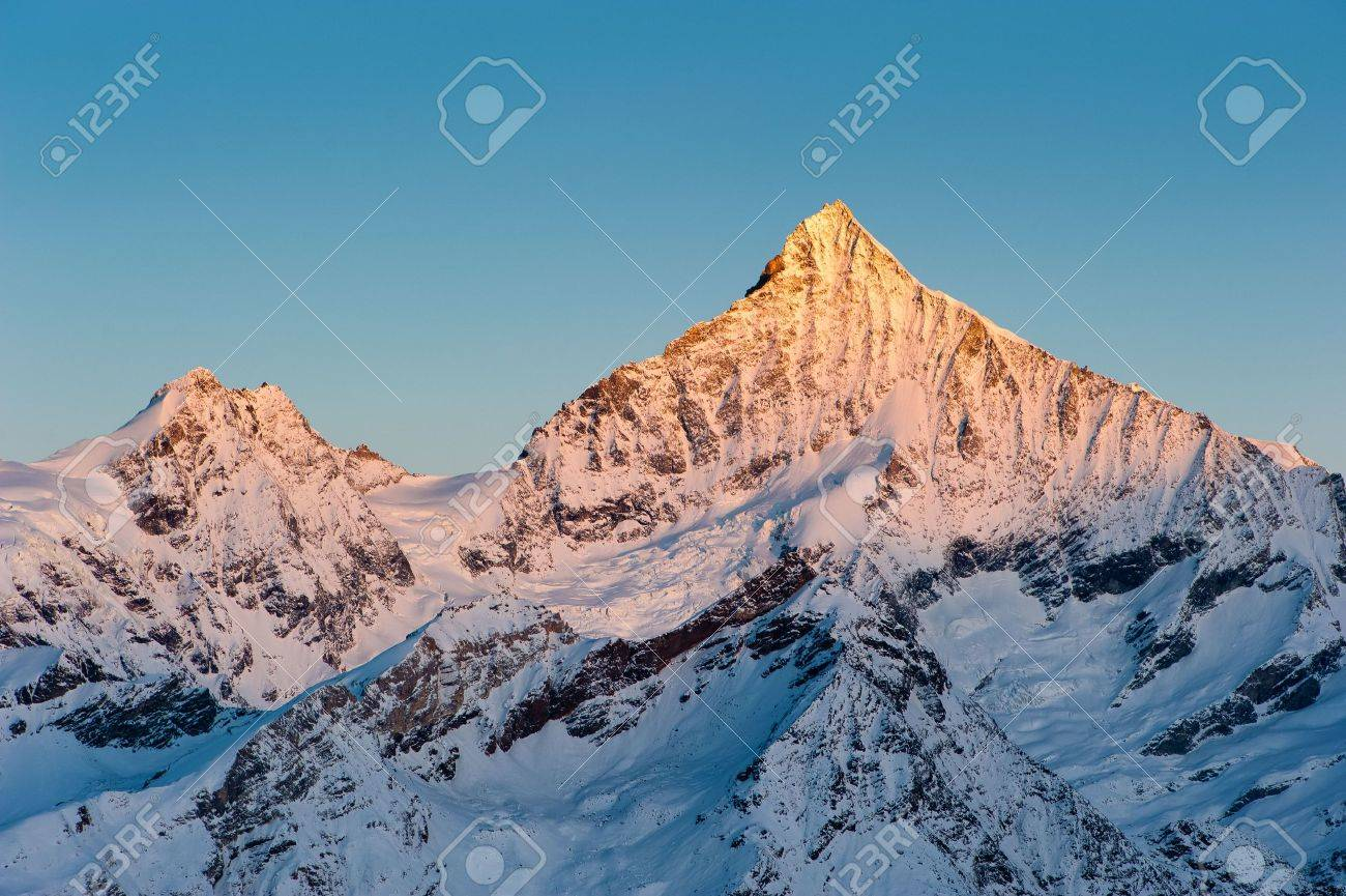 Weisshorn mountain peak at sunrise, view from Gornergrat, Zermatt, Switzerland Stock Photo - 6104461