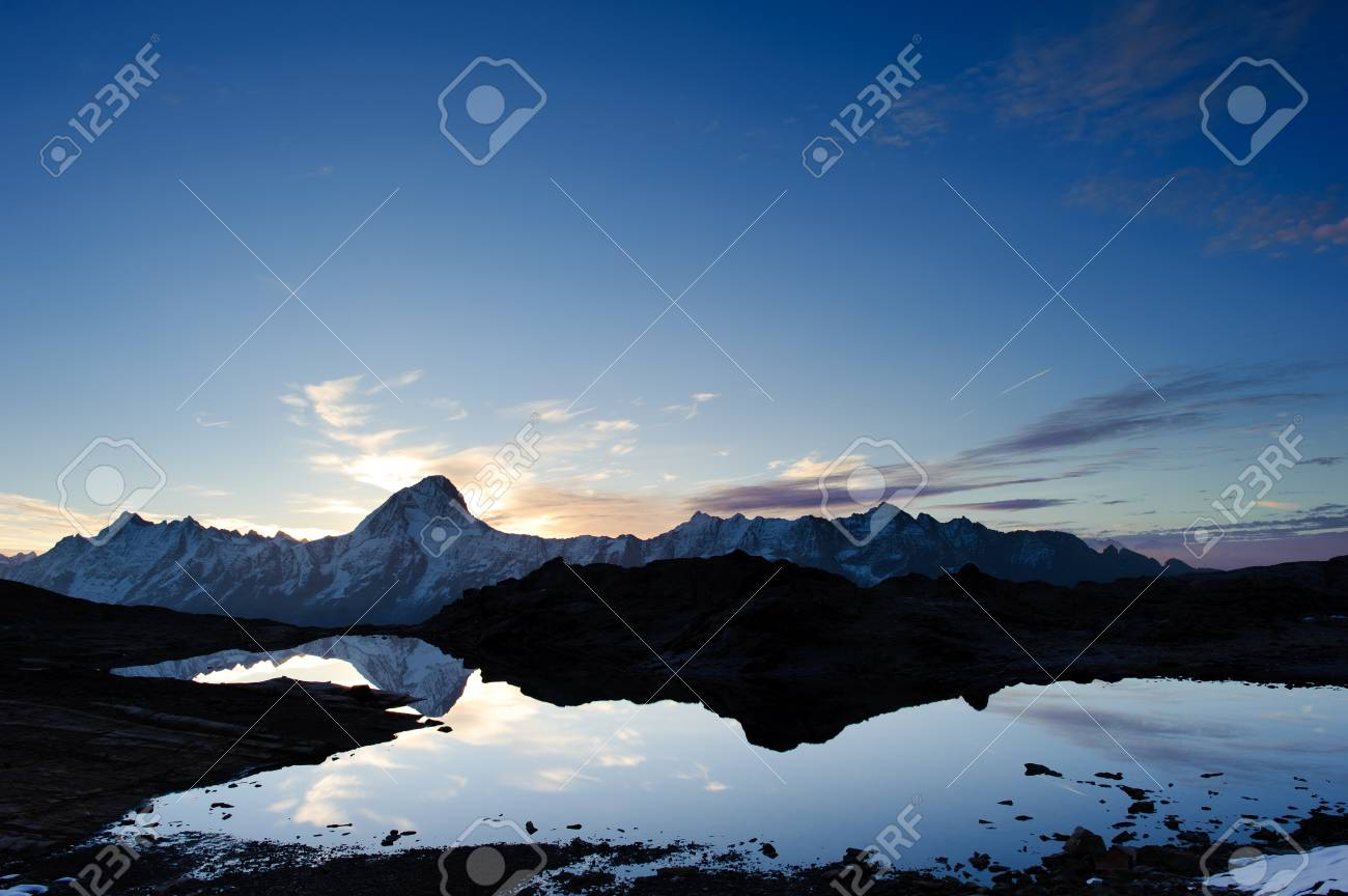 Bietschorn mountain peak at sunrise reflecting in small lake, Loetschenpass, Wallis, Switzerland Stock Photo - 8965861