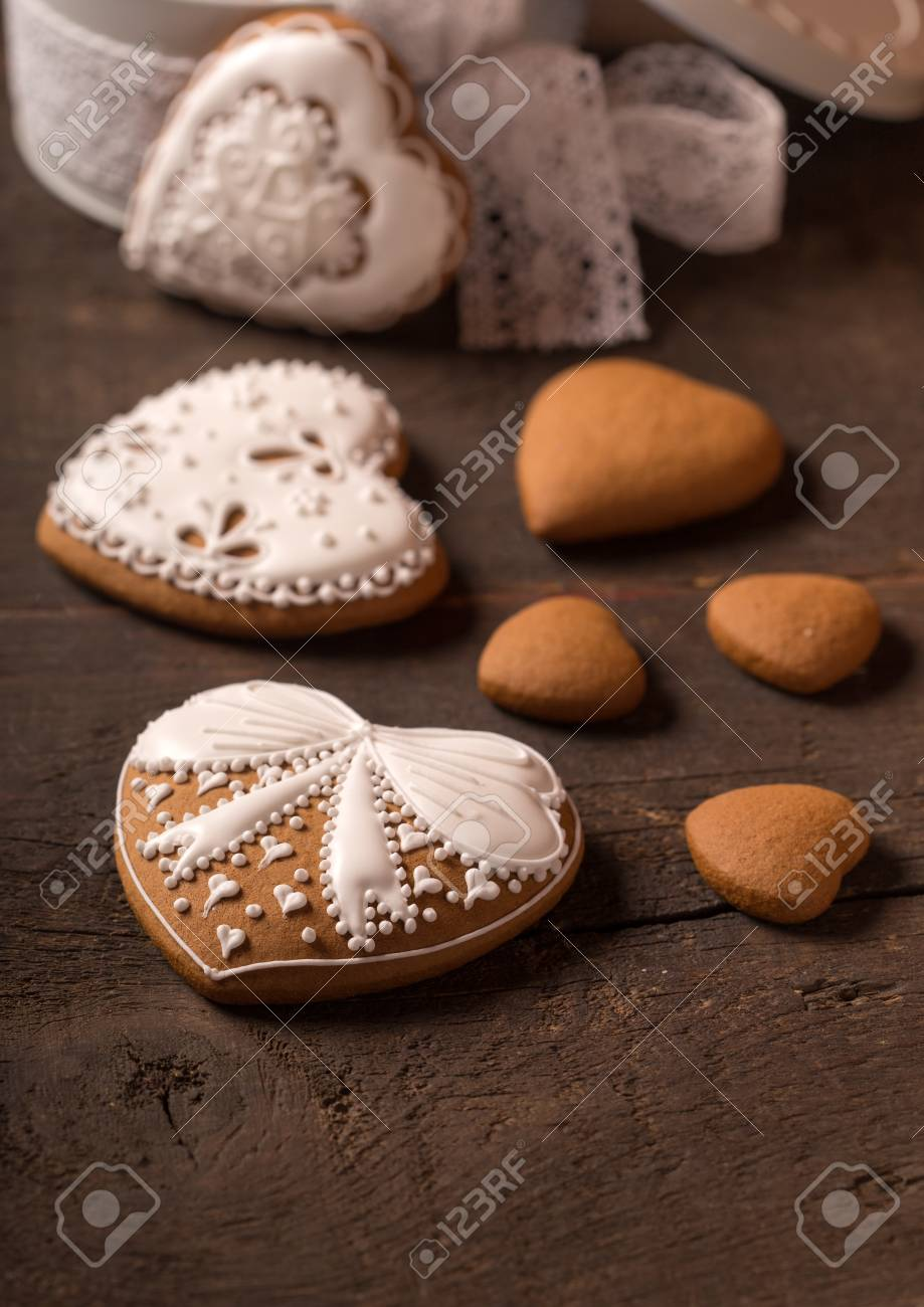 Beautiful Gingerbread Heart Cookies On A Wooden Brown Background