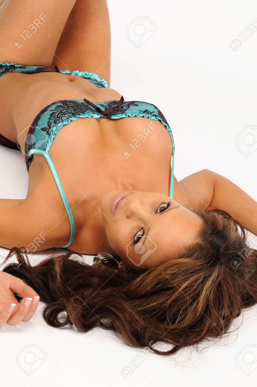 A sexy young woman laid on her back in blue lingerie Stock Photo - 12720613