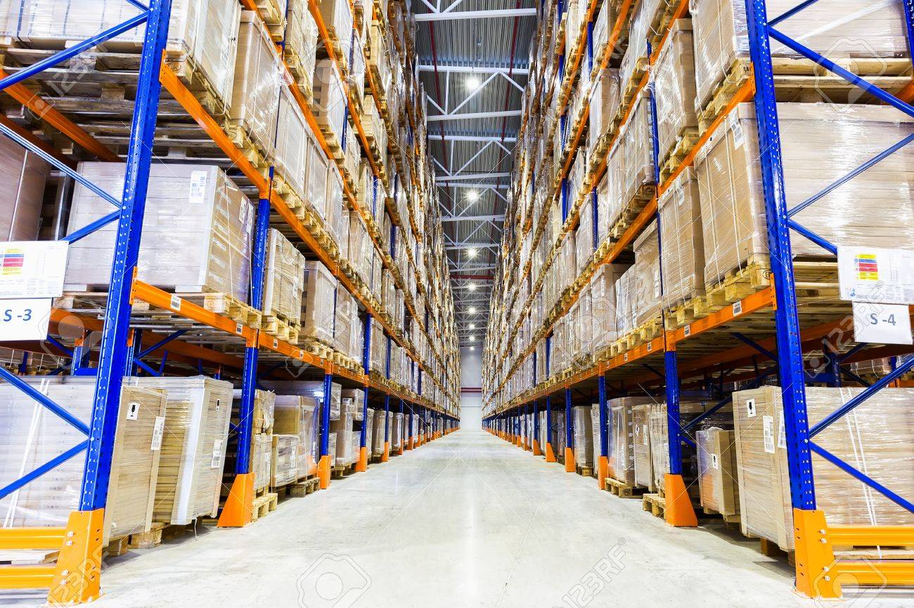 rows of shelves with boxes in modern warehouse stock photo picture