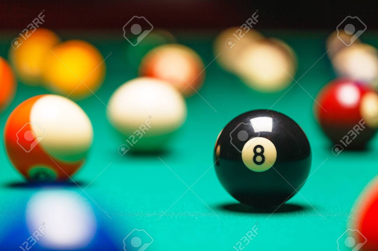 Billiard balls / A Vintage style photo from a billiard balls in a pool table. Noise added for a film effect - 50278300