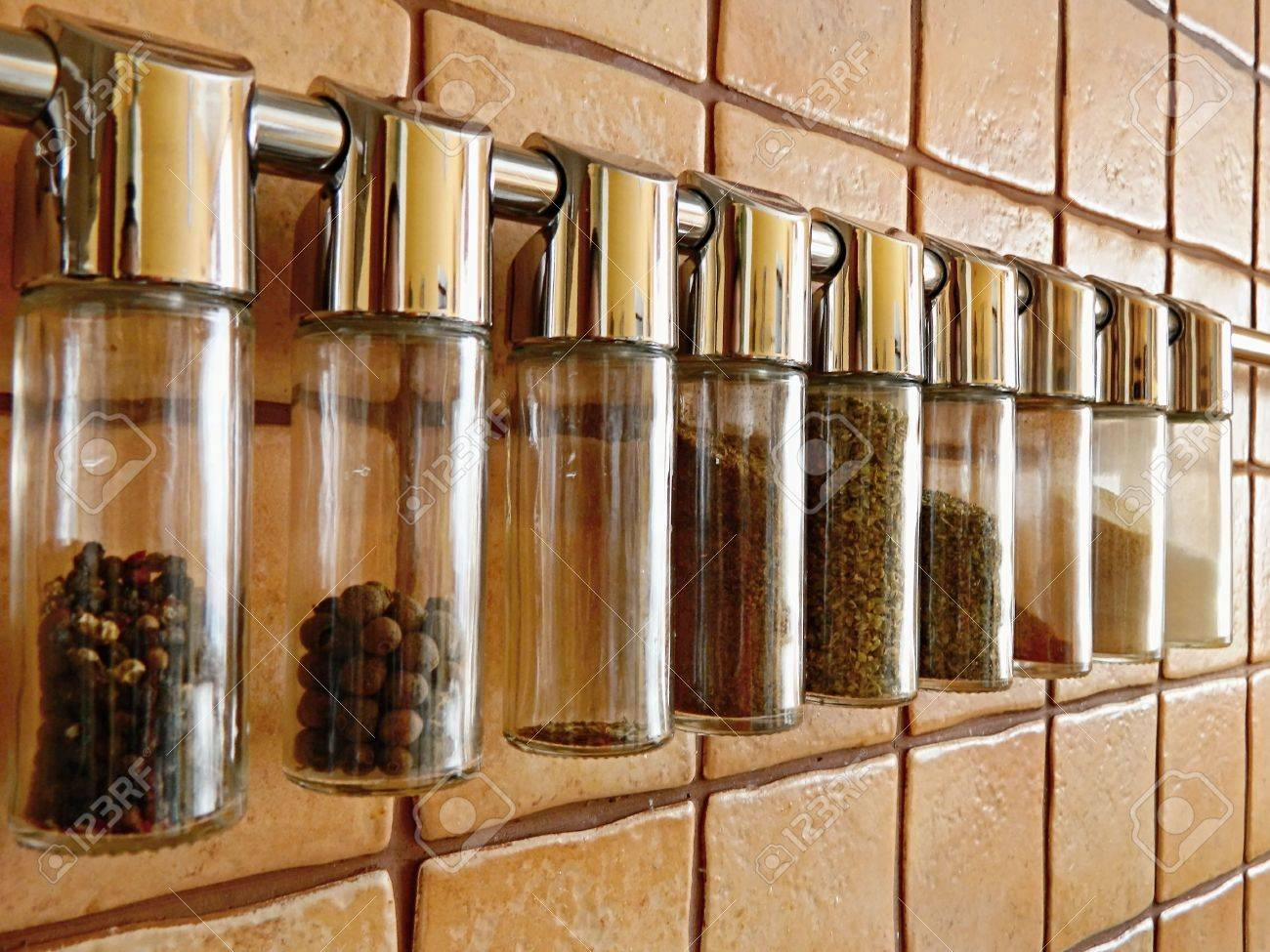 Glass spice rack hanging on stainless rod - 18572664