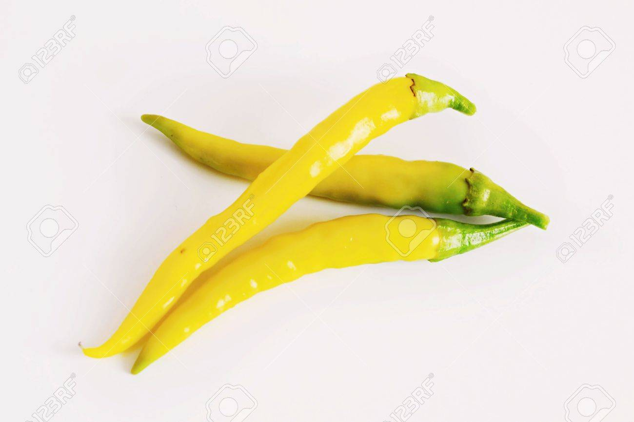 Yellow chili pepper on white - 23282060