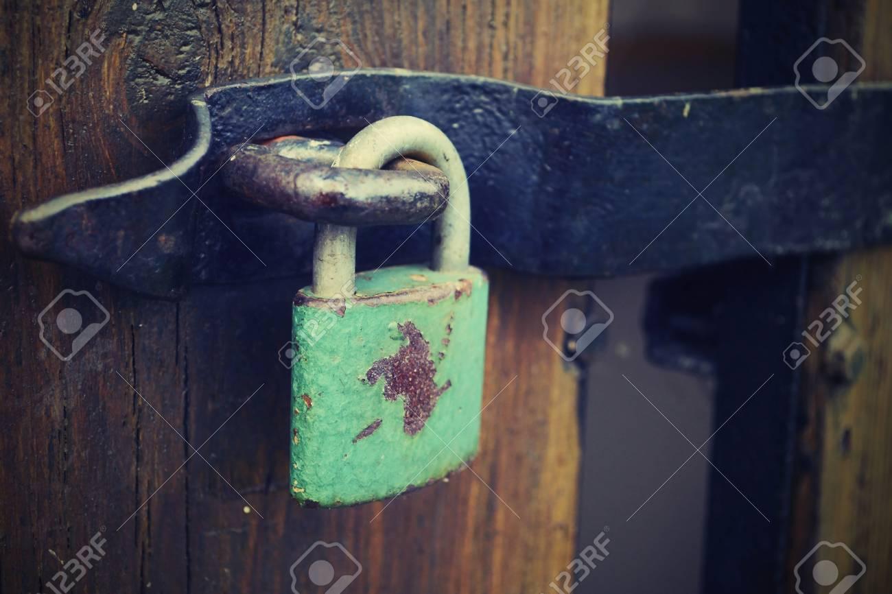locked old wooden door - 24804170