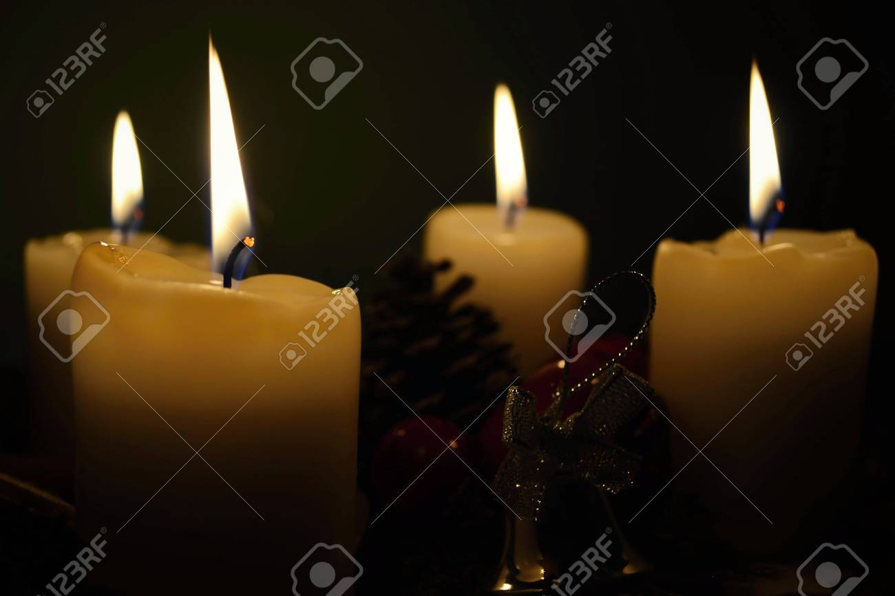 white candles in front of a black background - 27559747