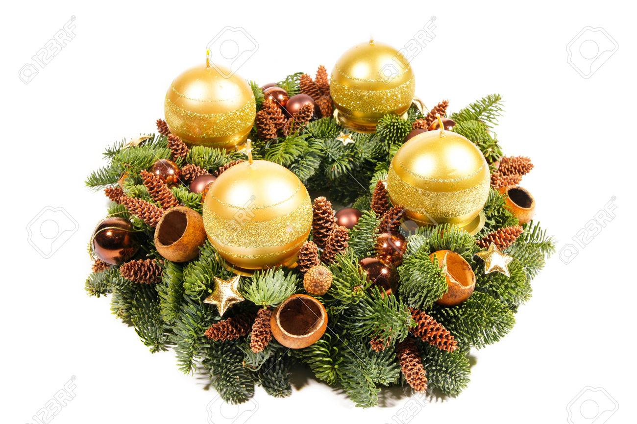 advent christmas wreath with gold candles on isolate background