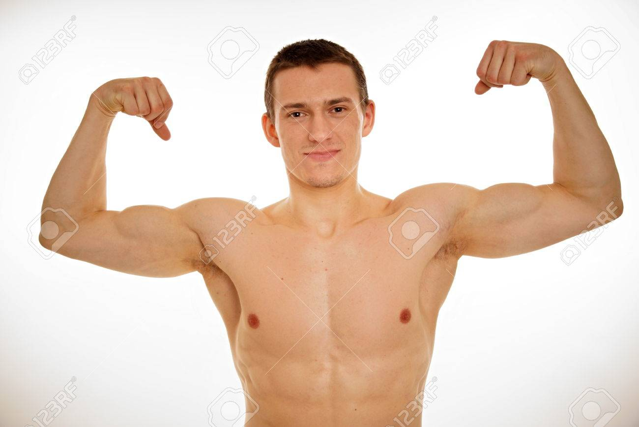 Athlete Young Man With No Shirt Shows His Biceps Stock Photo