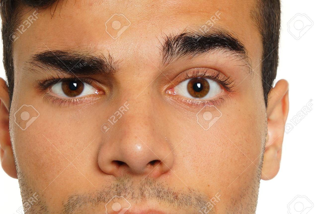 Face Close Up Of Young Man With A Raised One Eyebrow Stock Photo