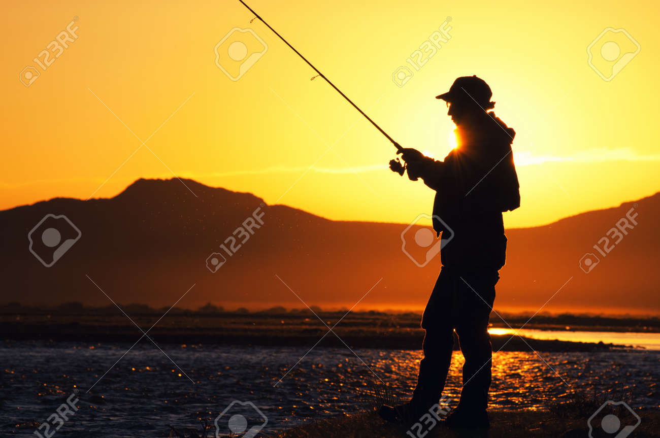 Fishing in the Mongolia - fisherman silhouette Stock Photo - 15126819