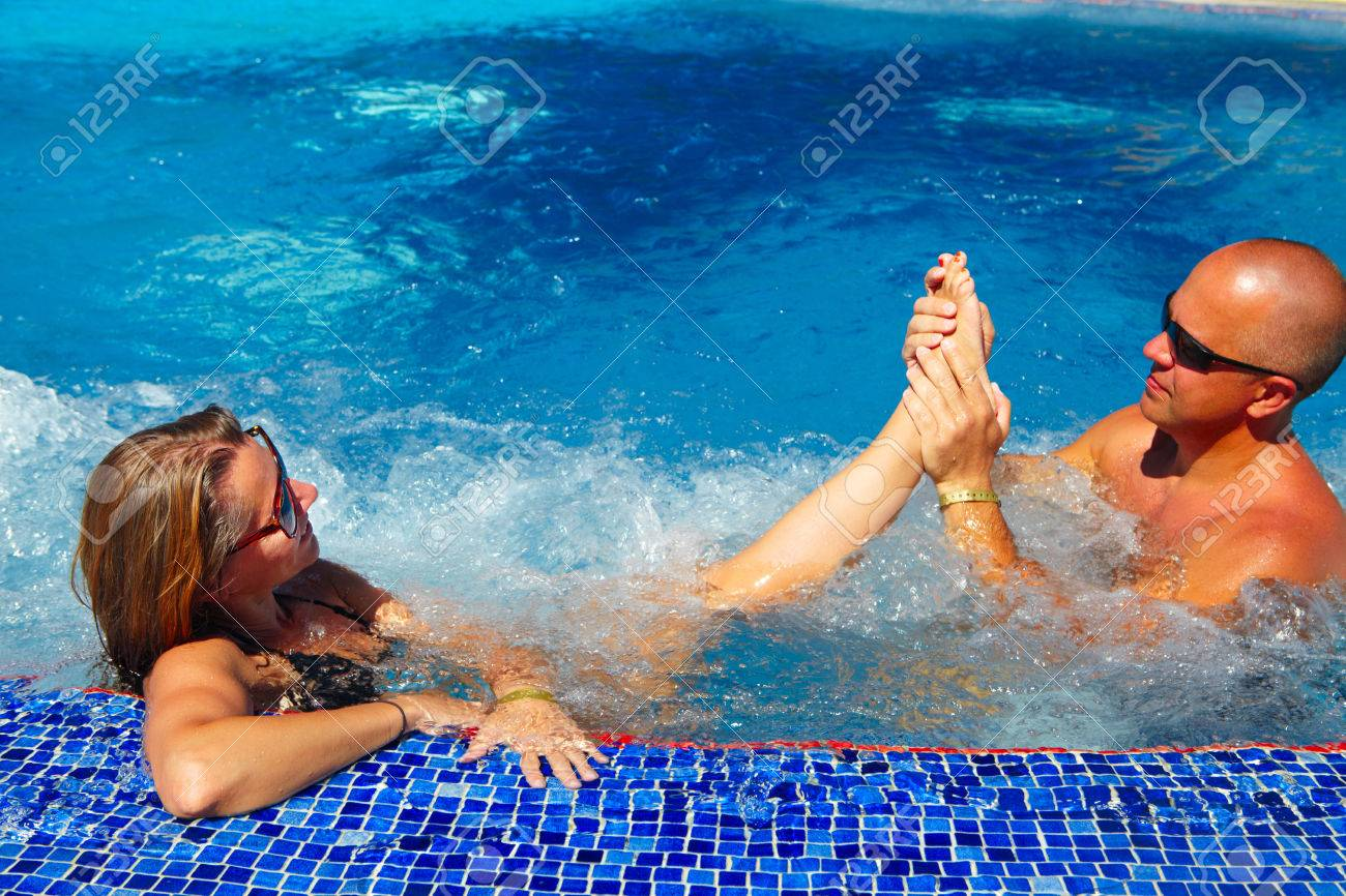 Romantic Couple Having Foot Massage In Jacuzzi Stock Photo, Picture ...
