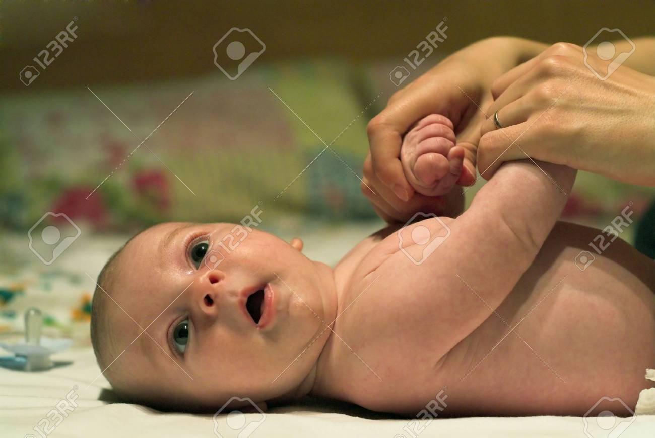 Young mother is doing morning exercises with her son. Shallow depth of field. Stock Photo - 3596087