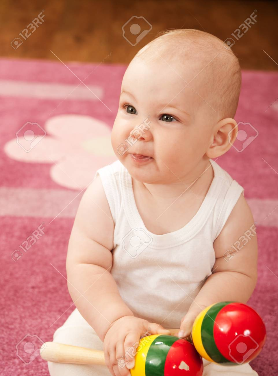 Cute baby girl s playing with toys in playroom Stock Photo - 9883953