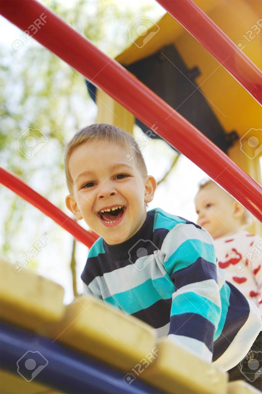 Laughing brother and his little sister on playground Stock Photo - 13873110