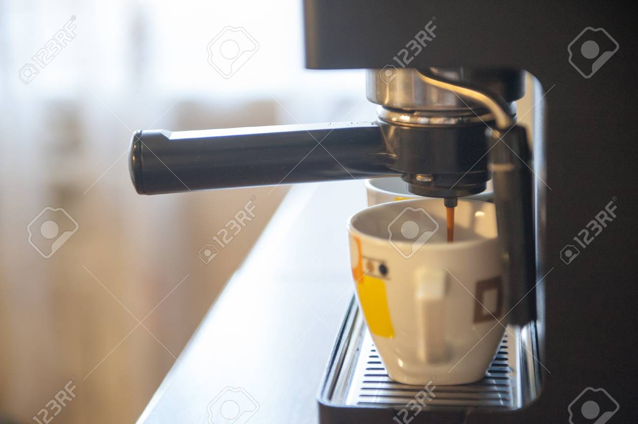 Coffee making using espresso machine at home Stock Photo - 14565288