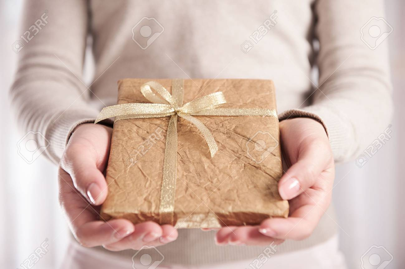 Young girl holding present box with ribbon bow Stock Photo - 15705019