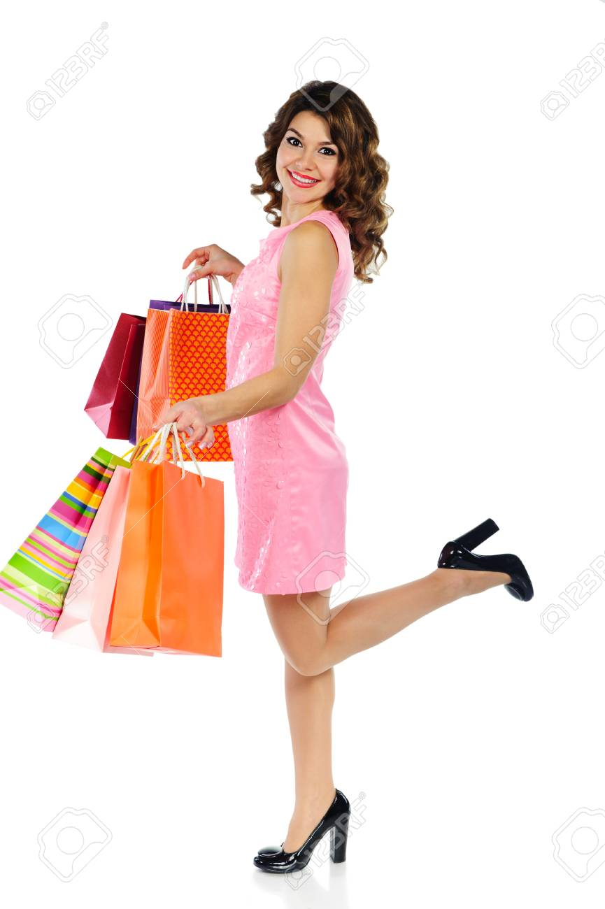 Young happy woman with shopping bags isolated on white background Stock Photo - 17505792