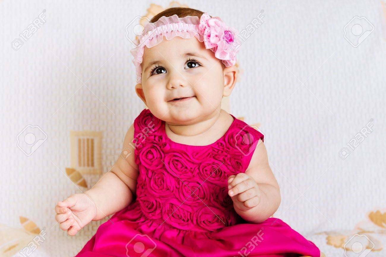 b7ca947eb40e6 Cute baby girl in pink floral dress Stock Photo - 18411291