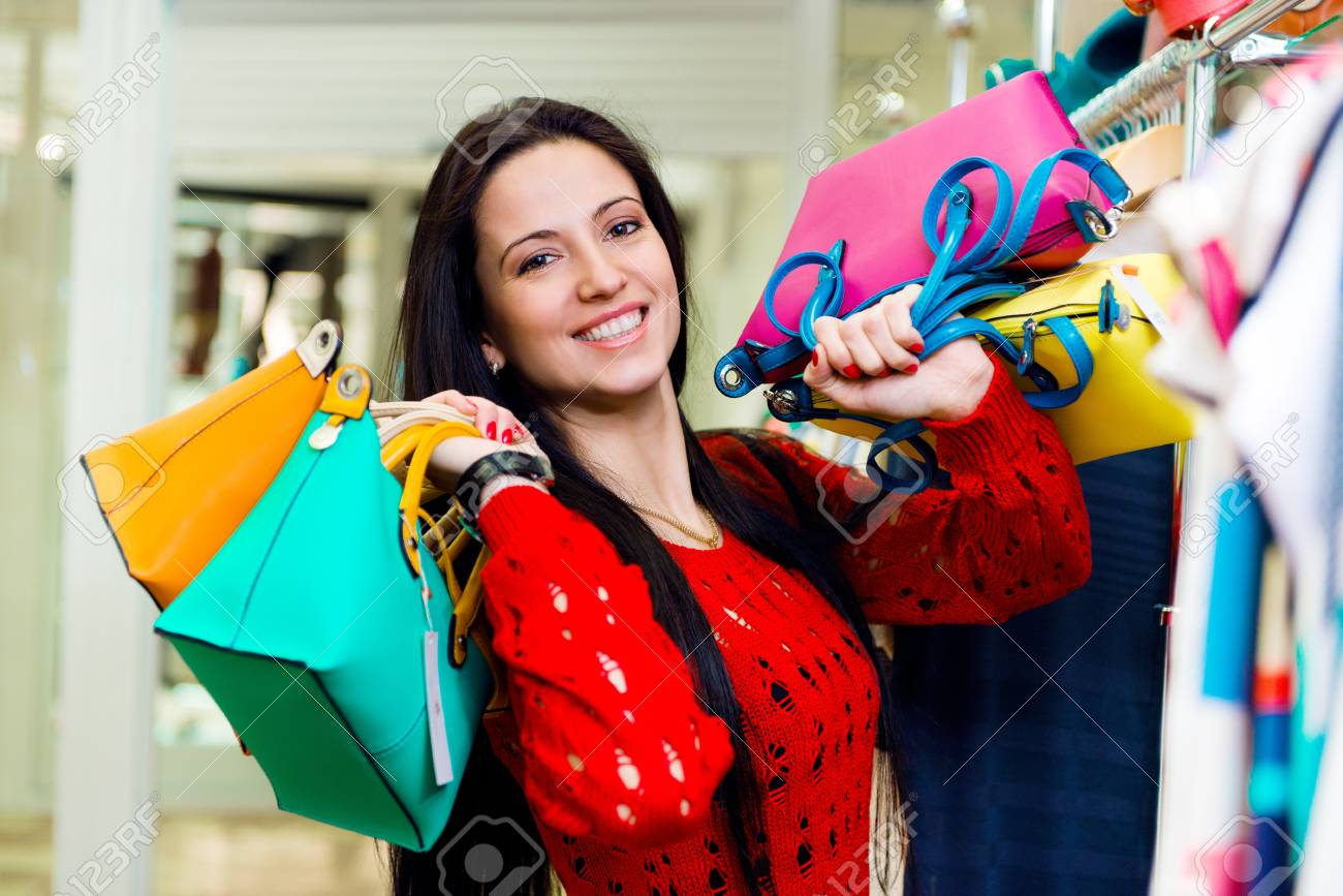Beautiful smiling young girl with shopping bags in mall Stock Photo - 19098315