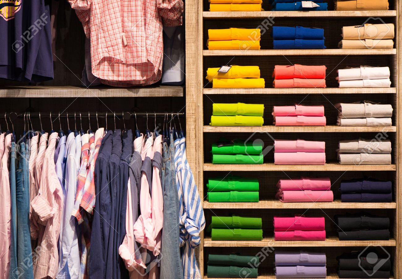 Stock Photo - Various colour shirts at shelf in shop c01ff38684f