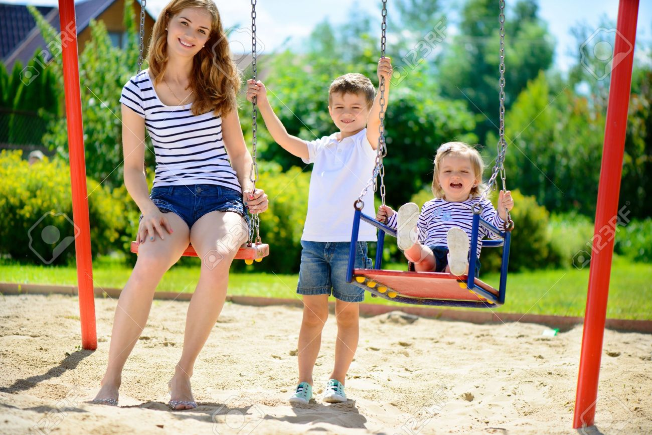 Happy mother and her children on playground Stock Photo - 20996452