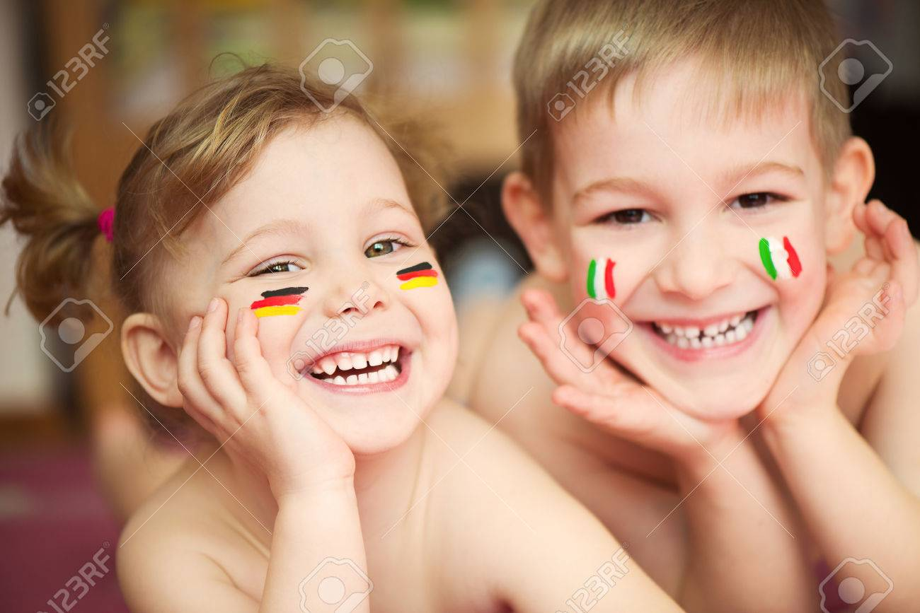 Cute little brother and sister with European flags on cheeks Stock Photo - 27431307