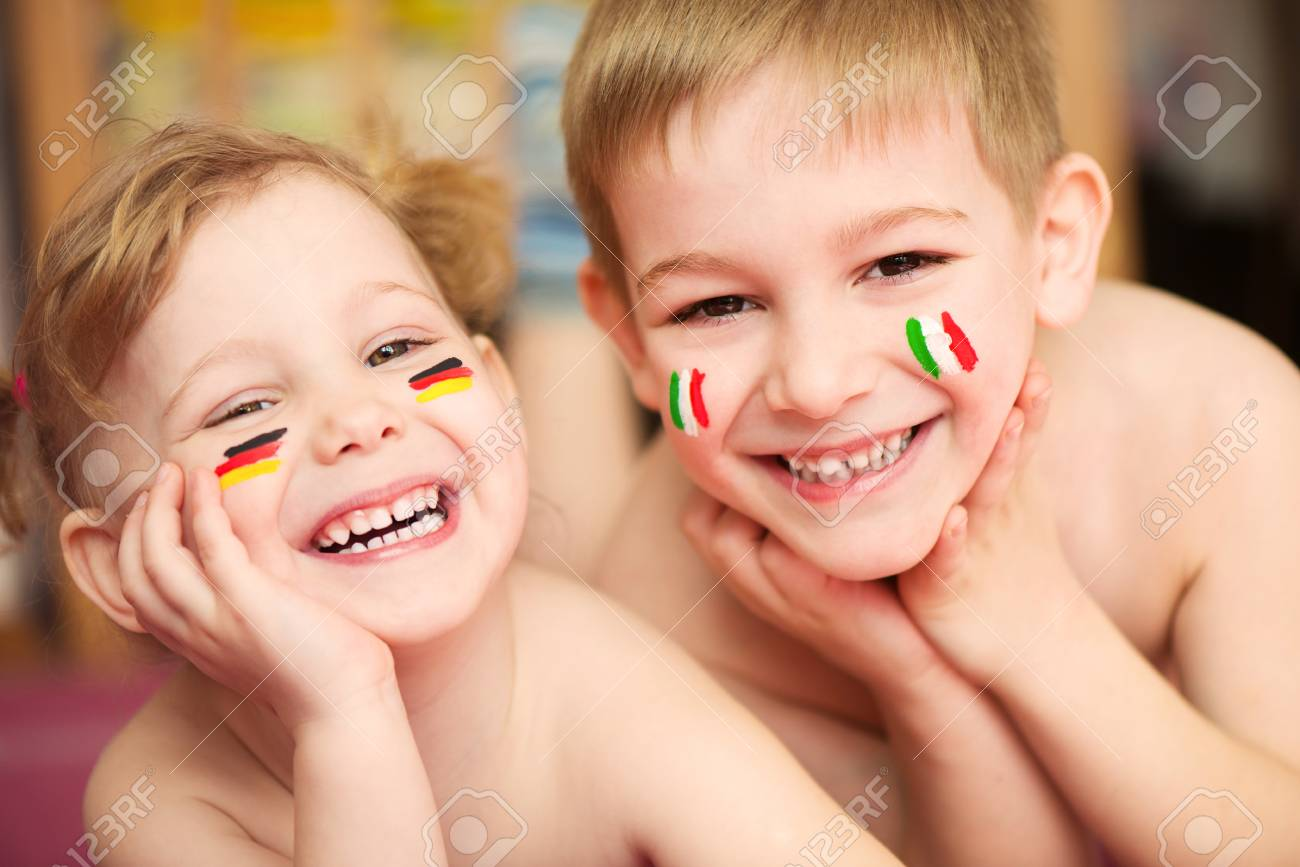 Cute little brother and sister with European flags on cheeks Stock Photo - 27431308