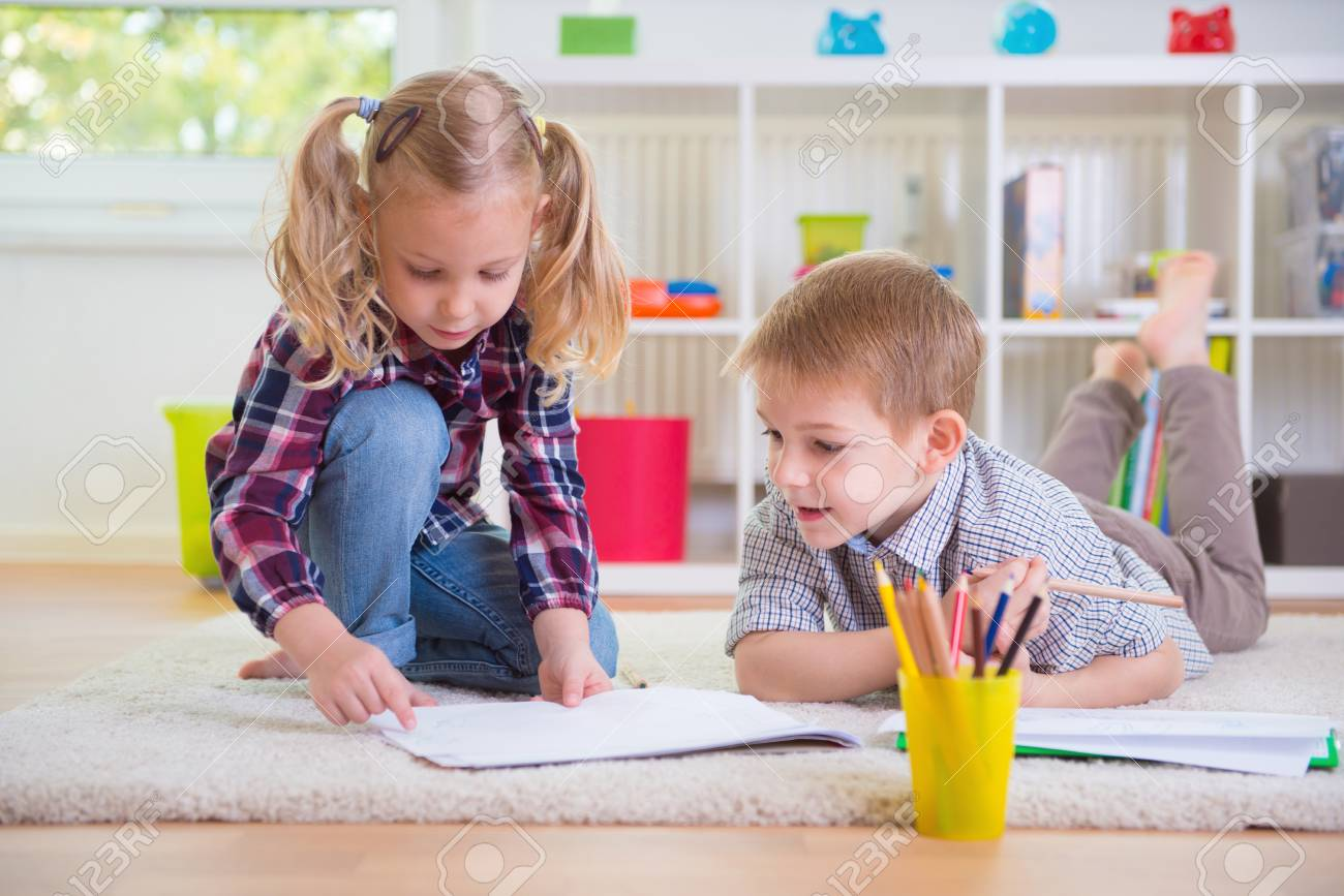 Two cute children draws on floor at home - 46332947