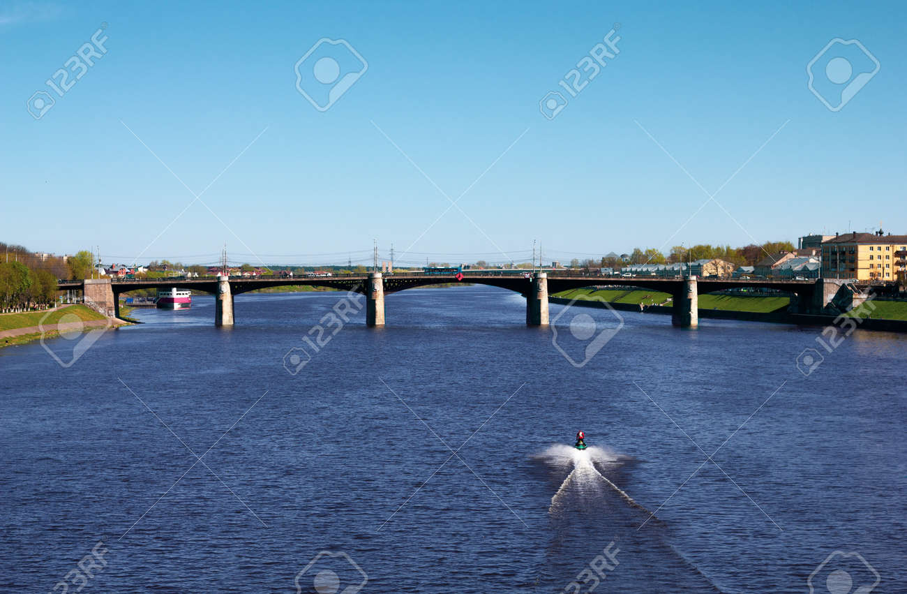 TVER, Russia, May 2021: View of the Novovolzhsky Bridge on the Volga River in Tver. Boat on the Volga. Beautiful river landscape. - 170430021