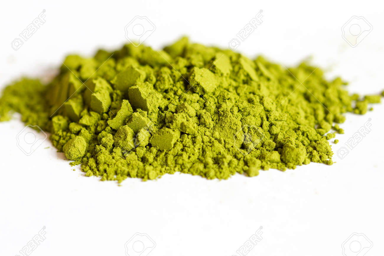 Powdered green matcha tea on a white isolated background close-up. Texture of matcha tea macro background. Copy space. Top view. - 170430052