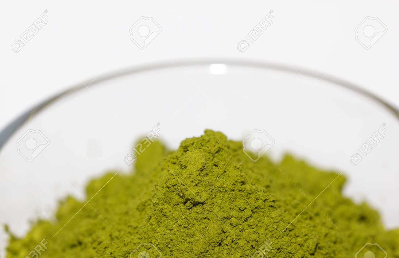 Powdered green matcha tea on a white isolated background close-up. Texture of matcha tea macro background. Copy space. Top view. Flat lay. - 170430095