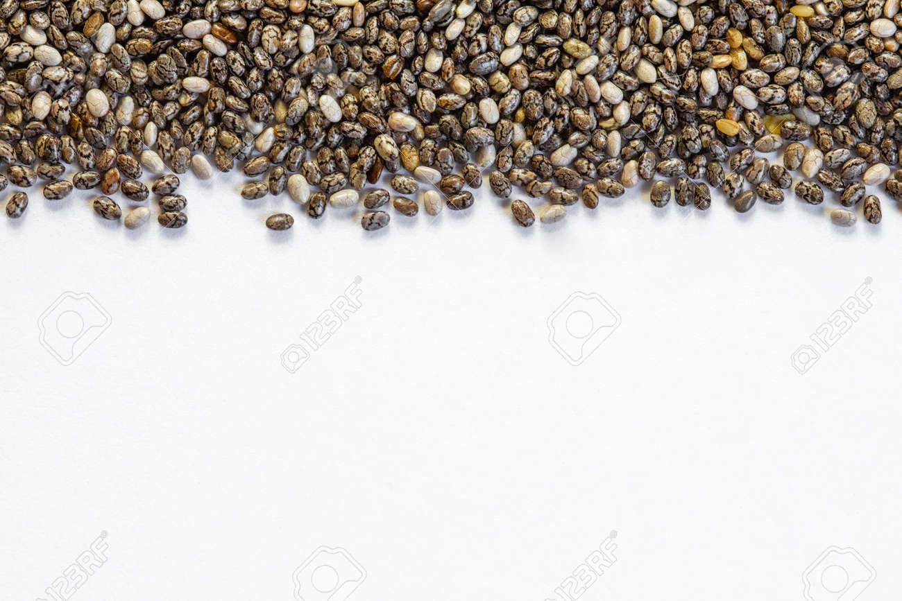 Chia seeds close-up background macro. The texture of the Chia seeds. Copy space. Flat lay. Chia seeds on a white background. Healthy food from Chia seeds. - 170430103