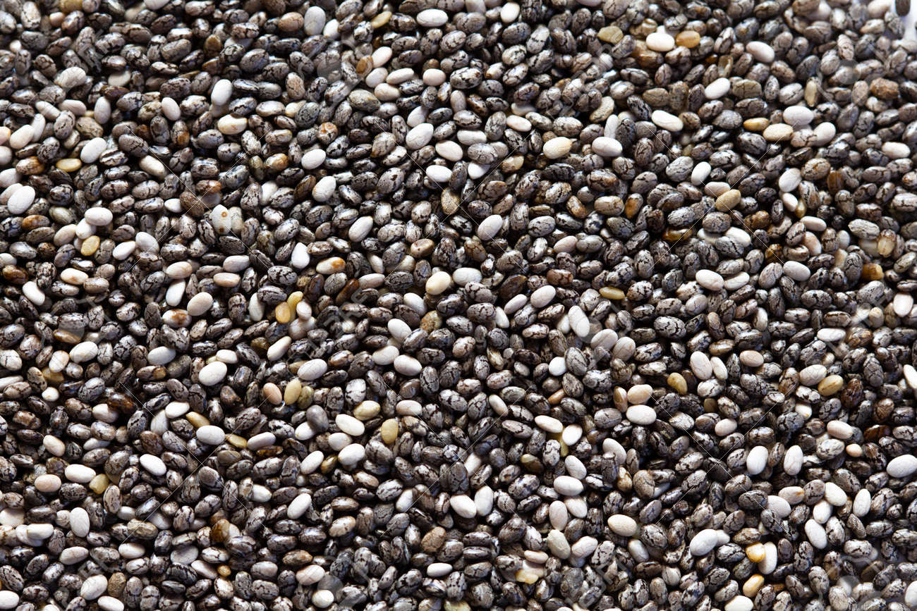 Chia seeds close-up background macro. The texture of the Chia seeds. Copy space. Flat lay. Healthy food from Chia seeds. - 170430155