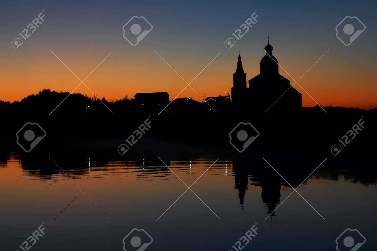 Silhouette of the Church of Elijah the Prophet at sunset in Suzdal. Nature background sunset on the river. - 171564892
