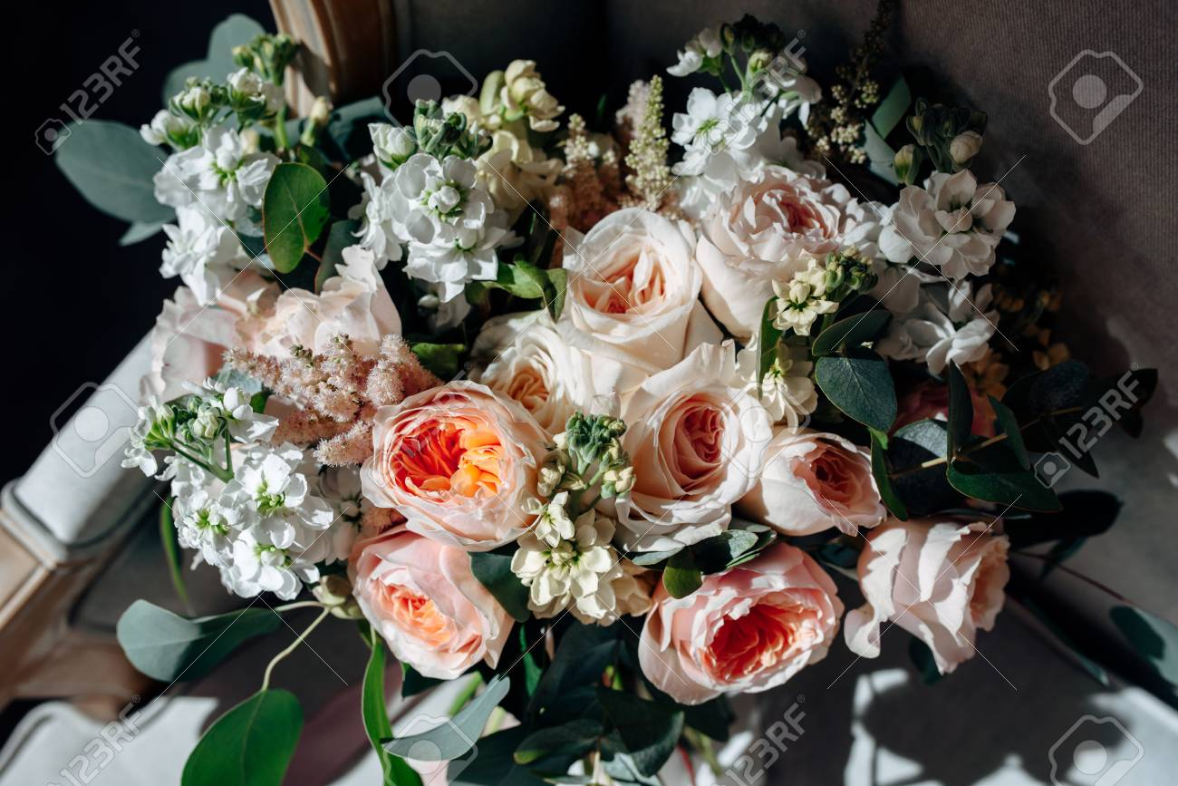 Wedding Bouquet With White Flowers Roses Greens And Ribbons