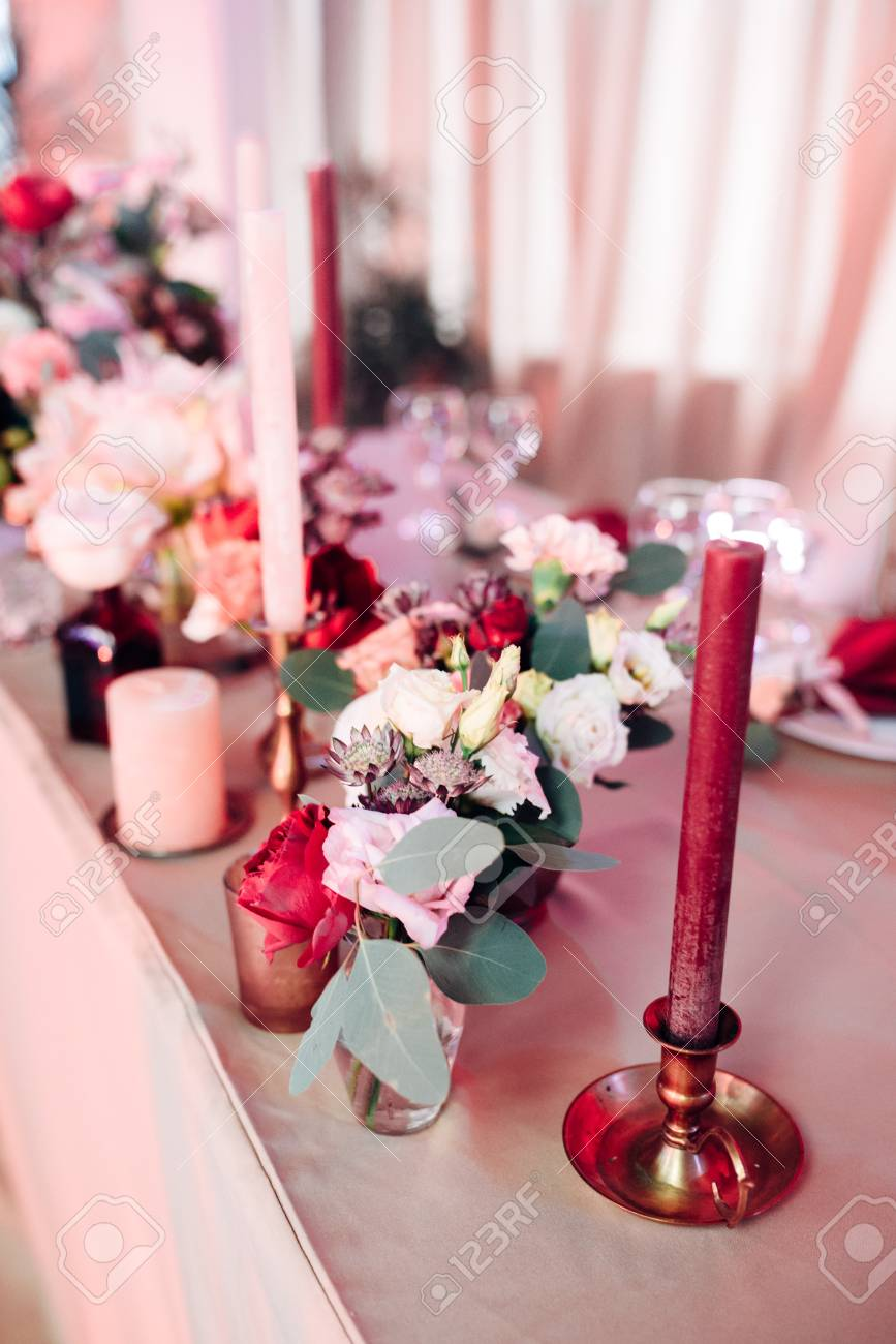 Decorated Area In Gold And Burgundy Colors With White Candles ...