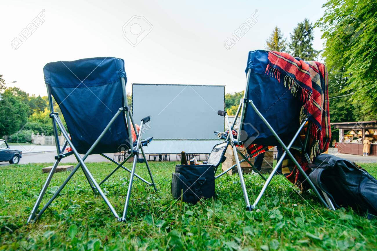 Super Open Air Cinema Concept Folding Chairs In Front Of Big White Ncnpc Chair Design For Home Ncnpcorg