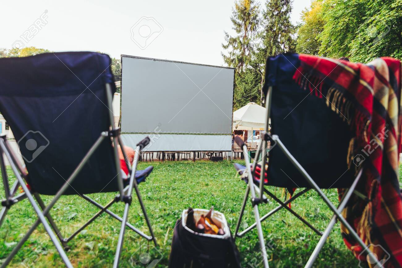 Terrific Open Air Cinema Concept Folding Chairs In Front Of Big White Ncnpc Chair Design For Home Ncnpcorg
