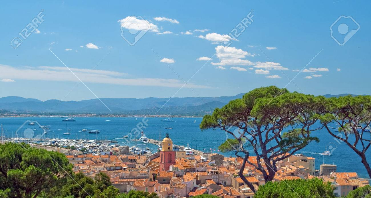 Image made with a sublime place of St Tropez, where the red roofs of the houses and the azure shore away from the horizon of the mountains. - 41811931