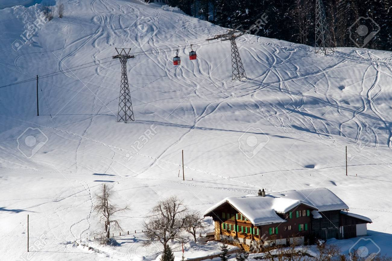 aerial view of cableway and hotels in switzerland ski resort.. stock
