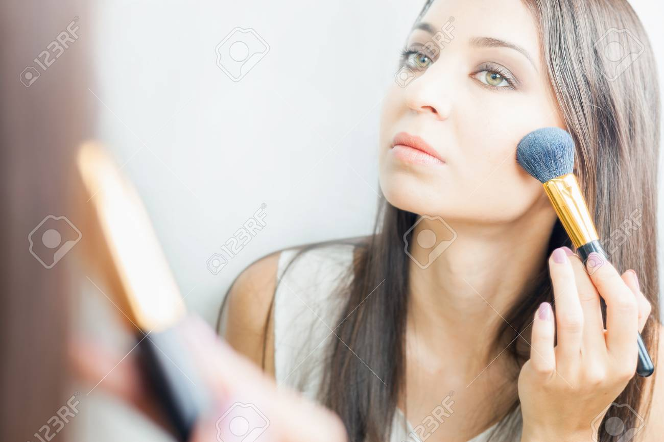 Makeup artist woman doing make up using cosmetic brush applying makeup artist woman doing make up using cosmetic brush applying eye shadow on face for solutioingenieria Image collections