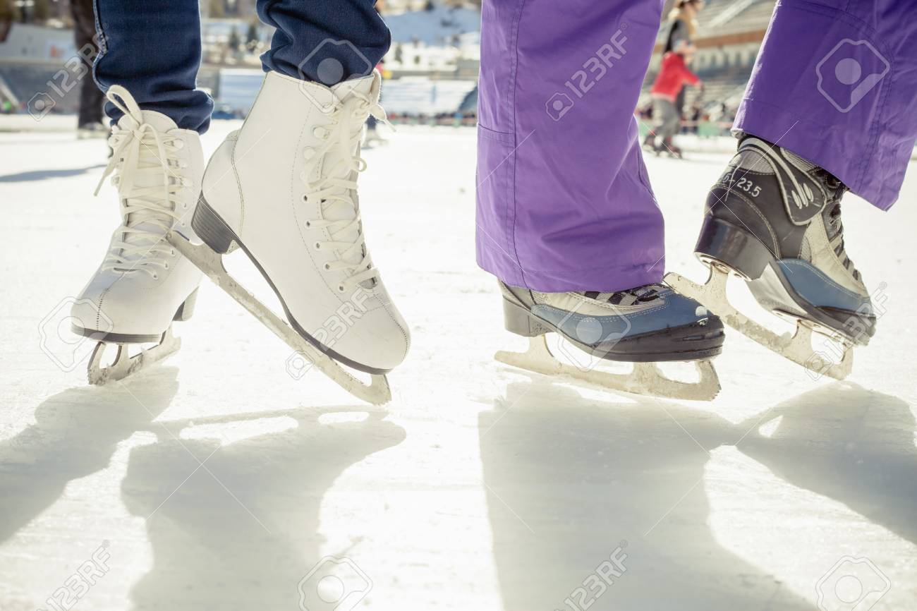 Closeup skating shoes ice skating outdoor at ice rink. Healthy lifestyle and winter sport concept at sports stadium - 47057165