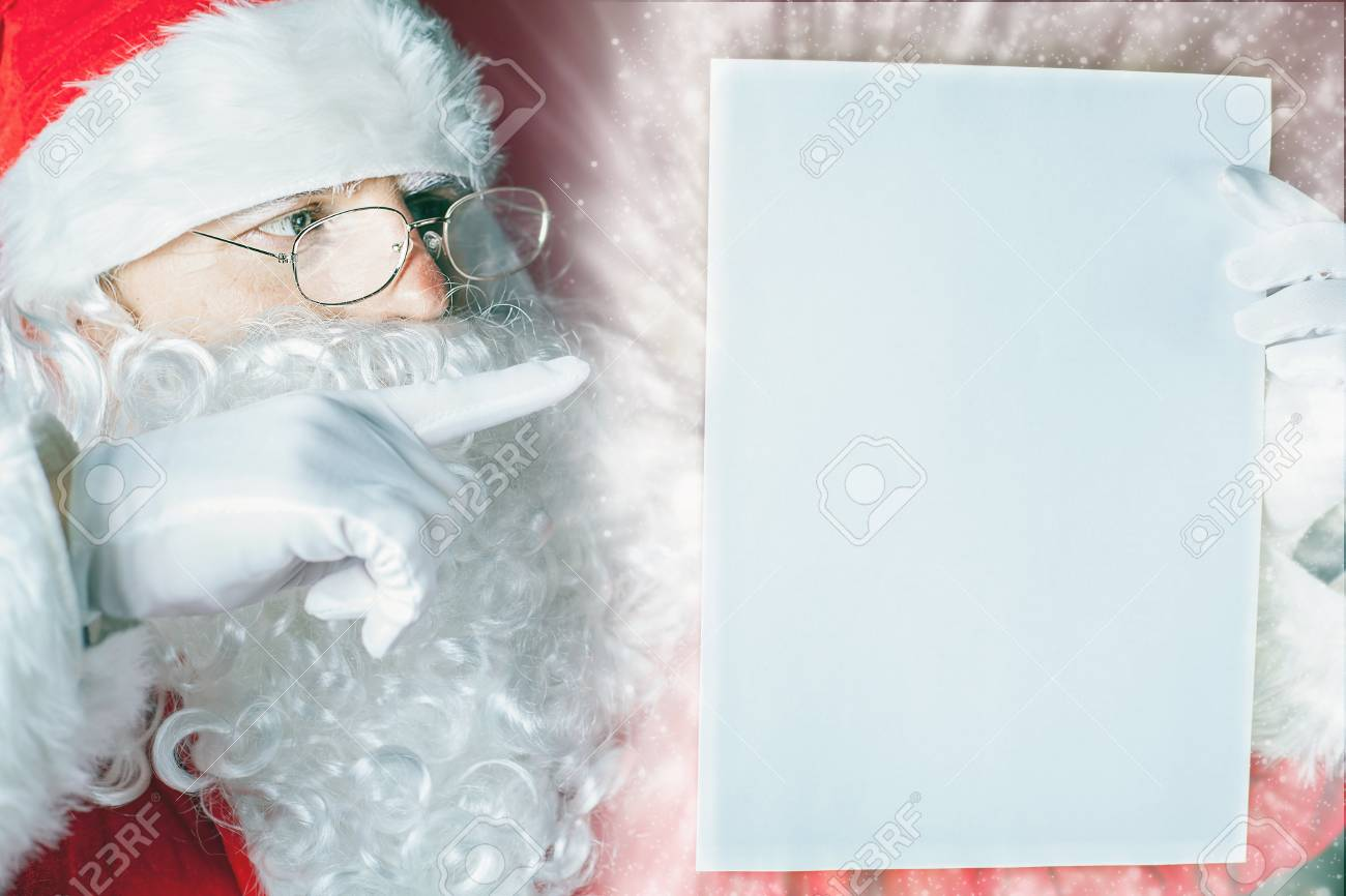 Santa Claus Holding A Wishlist, White Letter Or Paper. You Can ...